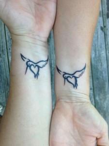 парные татуировки птицы